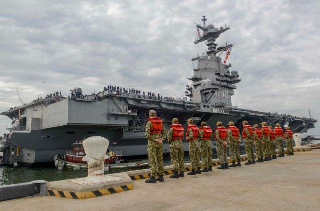 The aircraft carrier USS Gerald R. Ford will undergo shock trials before a planned maintenance program that will include installation and certification of its non-working weapons elevators. Photo by MCS Nikita Custer/U.S. Navy