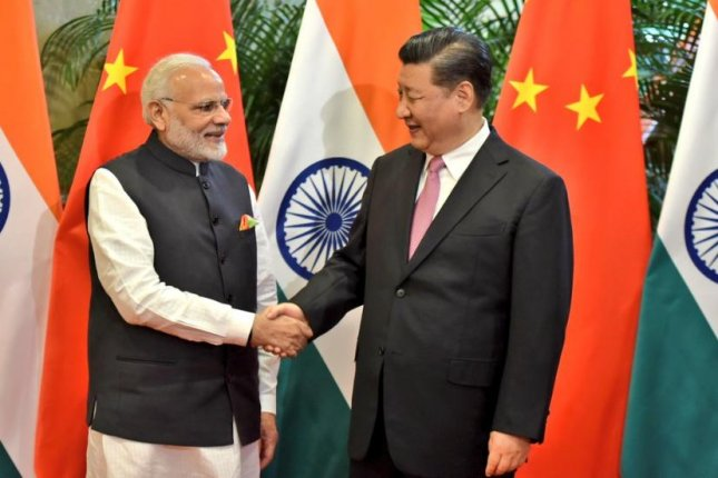 During an unprecedented informal summit in China, India Prime Minister Narendra Modi on Friday told China President Xi Jinping the two countries have a big opportunity to work together to benefit their people and the world. Photo courtesy Raveesh Kumar, India's Ministry of External Affairs spokesperson/Twitter