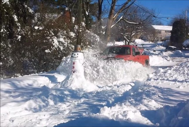 Bad news is headed for this Virginia snowman. Newsflare video screenshot