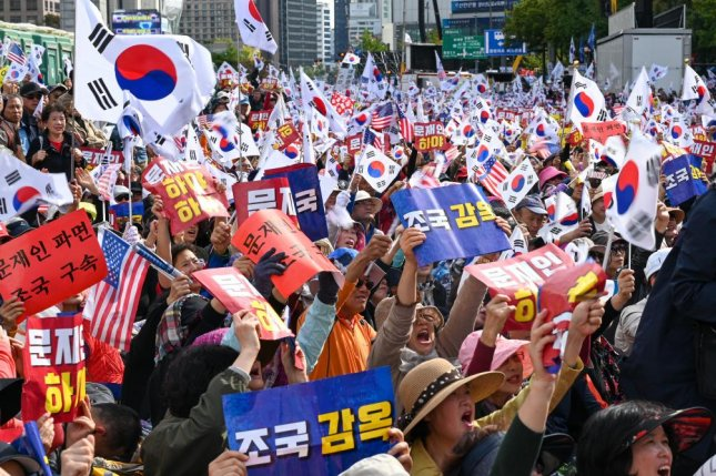 Protesters rally in Seoul on Wednesday calling for the resignation of President Moon Jae-in and Justice Minister Cho Kuk, who is facing corruption allegations. Photo by Thomas Maresca/UPI