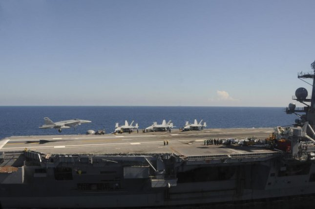Boeing has been awarded a maximum $52 million delivery order for work on F/A-18 Super Hornet aircraft access doors. A super Hornet is shown landing on the USS George H.W. Bush aircraft carrier in August. U.S. Navy photo