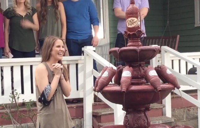 Clair Daniels, a Kansas State University student, received a decorative, outdoor Dr. Pepper fountain after Tweeting about how often she drinks the soda. 
