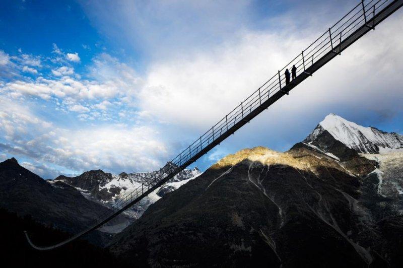 People walk on the 'Europabruecke' bridge, the world's longest pedestrian suspension bridge after the official inauguration in Randa, Switzerland. Photo by Valentina Flauraud/EPA