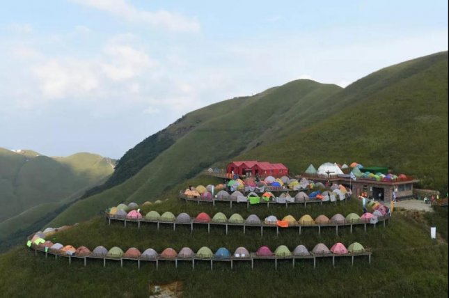 A total 721 tents were pitched on a mountain walkway in China to break the Guinness World Record for longest line of tents. Photo courtesy of the Wugong Mountain Scenic Area