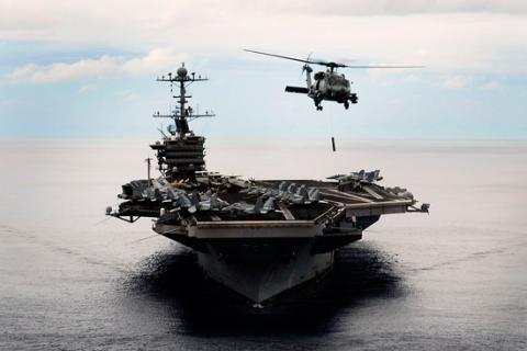 A MH-60R Seahawk helicopter deploys a AN/AQS-22 dipping sonar off a Nimitz-class aircraft carrier. Photo courtesy Raytheon
