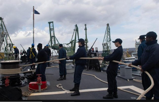 Personnel aboard the destroyer USS Ross handle a line as the ship arrived in Varna, Bulgaria on February 27, 2020. The ship has been in the Black Sea, performing training exercise with NATO partners, since February 23, 2010. Photo by MCS3 Andrea Rumple/U.S. Navy