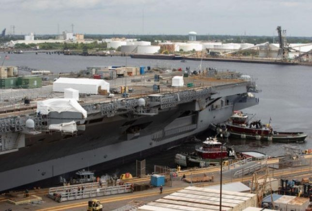 The aircraft carrier USS George W. Bush moved from drydock on Saturday after an 18-month maintenance period. Photo by David DeAngelis/Norfolk Naval Shipyard/Department of Defense