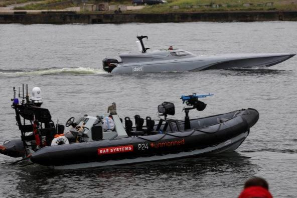 An inflatable vessel of the British Navy, in background, combining the capabilities of a drone and a boat, was publicly tested in London on Wednesday. Photo courtesy of Royal Navy