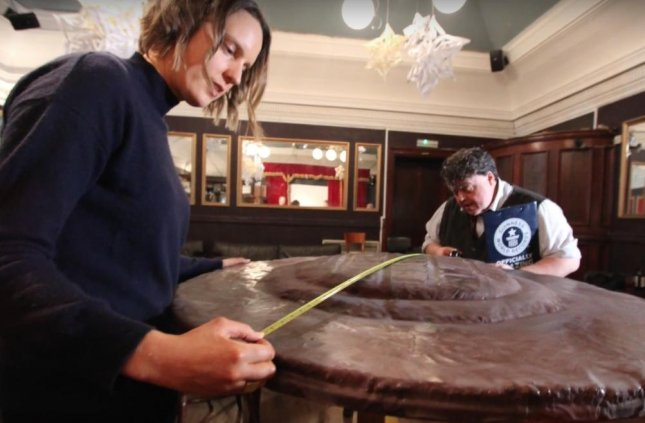 Former winner of The Great British Bake Off Frances Quinn teamed up with the staff at Hambleton Bakery in England to bake the world's largest Jaffa cake measuring four feet wide with a surface area of more than 13 feet. Screen capture/Guinness World Record/YouTube