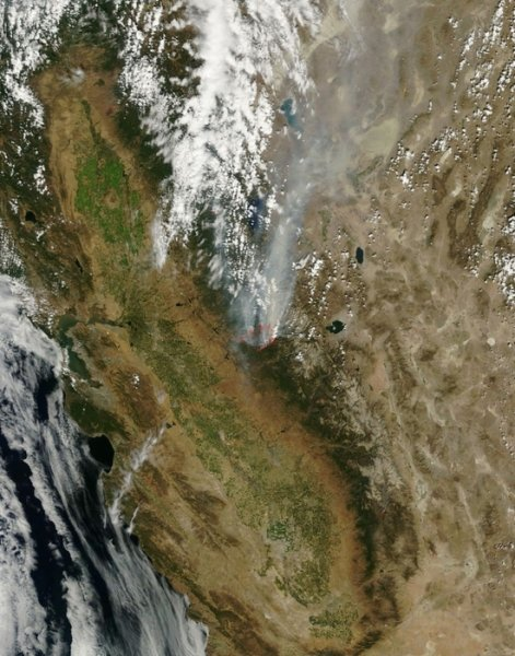 A NASA satellite photo taken Sunday, Aug. 25, 2013, shows the flames and smoke from the ravenous Rim fire in California's central Sierra Nevada region.