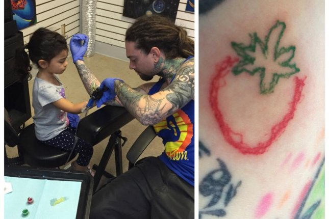 A Florida father allowed his 4-year-old daughter to tattoo a strawberry on his arm. Photo by Brad Bellomo/Facebook