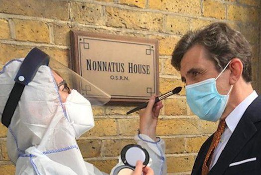 A makeup artist (L) works on Call the Midwife actor Stephen McGann this week during the coronavirus pandemic. Photo courtesy of BBC