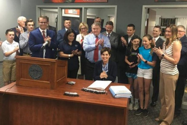 Iowa Gov. Kim Reynolds signs the state's Heartbeat Law abortion bill on May 2. Friday, a judge granted a temporary injunction until legal challenges to the law are resolved. Photo courtesy Office of the Iowa Governor