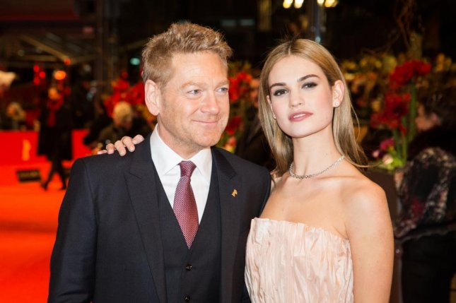 Cinderella director Kenneth Branagh and the movie's star Lily James at the 2015 Berlin Film Festival. Shutterstock