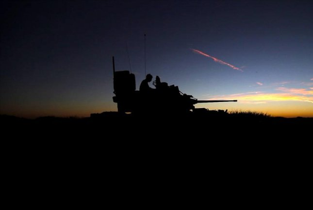 The Army's next-generation combat vehicle will likely run on hybrid power and feature laser weapons, possibly for offensive and defensive purposes, experts said during an event to discuss the system's future on Tuesday at the Association of the U.S. Army. A M2 Bradley fighting vehicle is shown here during an October exercise in Texas. U.S. Army photo
