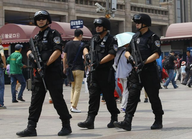 The latest attack in Xinjiang province in China took five lives, including four attackers shot dead by police, and injured three more after a car was driven into a Communist Party complex and a homemade bomb detonated. Chinese officials blame ongoing violence in Xinjiang and other parts of the country on Muslim extremists, and have moved to crack down on extremism, but experts say the attacks are the product of an abusive government. Chinese police, pictured, were deployed to patrol Beijing Railway Station in 2014 after a series of terror attacks that killed nearly 40 people. Photo by Rolex Dela Pena/European Pressphoto Agency