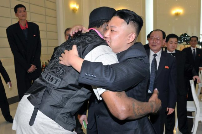North Korea's Kim Jong Un embraces retired U.S. basketball player Dennis Rodman on Feb. 28, 2013. A U.S. scientist who accompanied Rodman on some of his trips says the hug between the two men made a lasting impression on young North Koreans. File Photo by KCNA/EPA