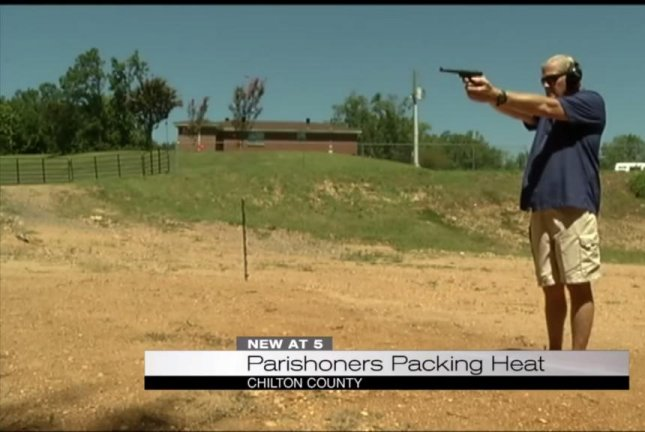 Pastor Phillip Guin of the Rocky Mount United Methodist Church fires a handgun at the Rocky Mount Hunt and Gun Club located behind the house of worship. WIAT42/YouTube video screenshot