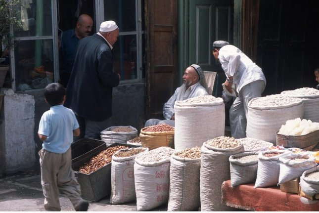 Local grains are still sold on the streets of the ancient Silk Road city of Kashgar in Xinjiang, China. Photo by Michael Frachetti/Washington University