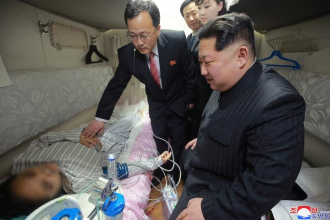 A photo released Thursday by North Korea's Central News Agency shows North Korean leader Kim Jong Un (R) visiting the Pyongyang Railway Station in Pyongyang, North Korea to check on Chinese survivors of a recent bus crash in North Korea. Kim is to meet with South Korean President Moon Jae-in on Friday. Photo courtesy of KCNA
