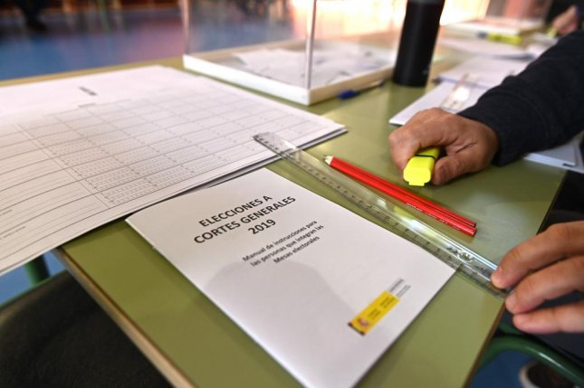 A man prepares election materials moments before the opening of a polling station in Alcala de Henares, Madrid Sunday. Photo by Fernando Villar/EPA-EFE