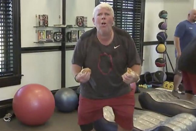 Golfer John Daly does a set of hamburger curls during a workout for Champions Tour Learning Center. Photo courtesy of the Golf Channel.