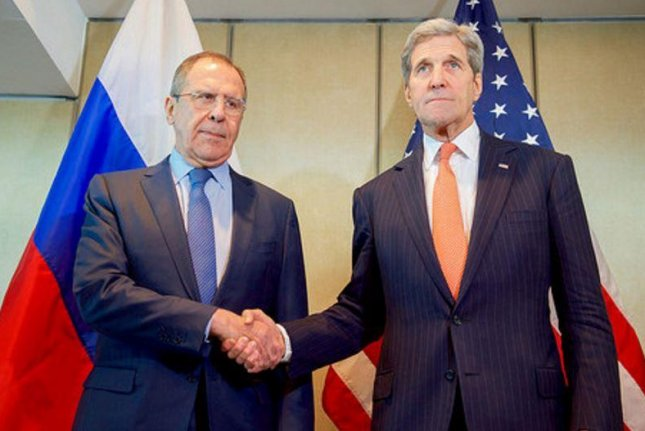U.S. Secretary of State John Kerry shakes Hands With Russian Foreign Minister Lavrov before meeting in Munich, Germany, on Thursday to work toward a ceasefire agreement. Photo by U.S. Department of State