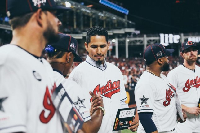 Indians pitcher Carlos Carrasco (middle) was diagnosed with chronic myeloid leukemia last month. Photo by MLB/Twitter
