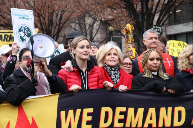 Actors Jane Fonda (2nd-R) and Taylor Schilling (2nd-L) participate in a march through Washington, D.C., asking companies to divest from private migrant facilities. Photo by Silvia Martelli/Medill News Service