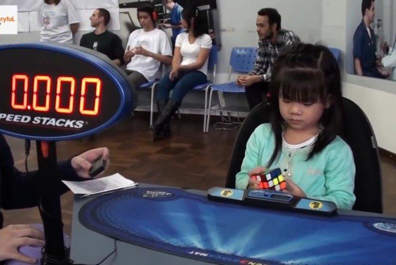 A 3-year-old girl takes on a Rubik's cube in Brazil. Screenshot: Storyful