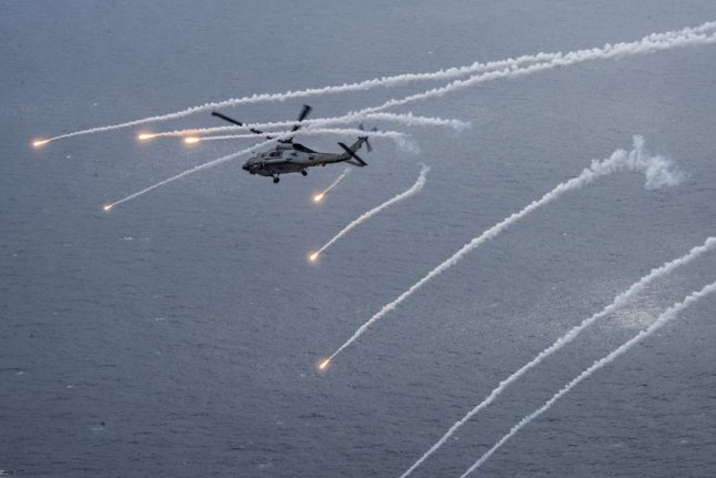 A U.S. Navy MH-60B Sea Hawk launches infrared countermeasure flares during an exercise. U.S. Navy photo