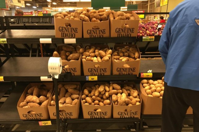 Fifty-pound boxes of potatoes normally sent to food service companies are being rerouted to grocery stores to meet surging consumer demand amid the coronavirus pandemic. Photo courtesy of the Idaho Potato Commission