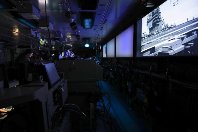 Sailors assigned to o USS Gerald R. Ford's combat systems department stand watch in the ship's combat direction center during sea based developmental testing. (This photo has altered for security purposes by blurring screens. Photo by Ruben Reed/U.S. Navy