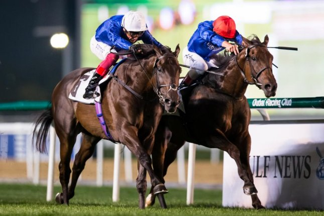 Volcanic Sky, with Frankie Dettori riding, wins Thursday's Group 3 Nad al Sheeba in Dubai and may start on World Cup night. Photo by Erika Rasmussen, courtesy of Dubai Racing Club