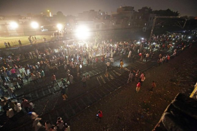 Train hits crowd at religious festival in India