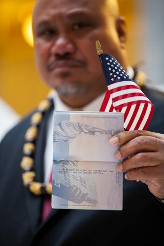 John Fitisemanu, one of three American Samoans in Utah who named in the court case, holds up a passport issued to American Samoans that states the bear is a United States National and not a United States citizen. Photo courtesy of Equally American/Website