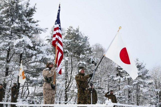 U.S. Marines and Soldiers from Japan Ground Self-Defense Force watch as flags are presented during an opening ceremony for exercise Northern Viper on Hokudaien Training Area, Hokkaido, Japan, Jan. 26, 2020. Photo by Cameron E. Parks/U.S. Marine Corps