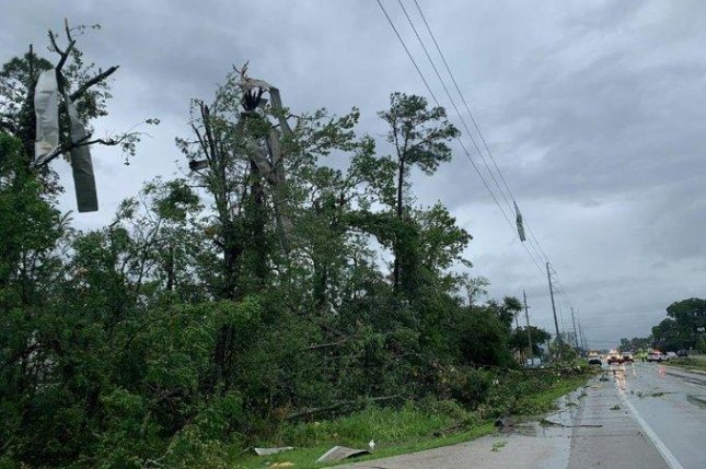 At least one person died in Jacksonville, Fla., due to a fallen tree, officials said. Photo courtesy of JEA/Twitter