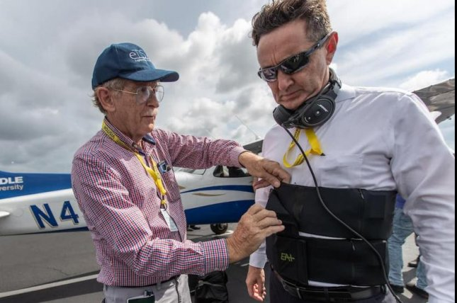 Angus Rupert, a medical research scientist for the U.S. Army, checks a sensory vest on Braden McGrath, a research professor at Embry Riddle Aeronautical University in Daytona Beach, Fla. Photo courtesy of Embry-Riddle