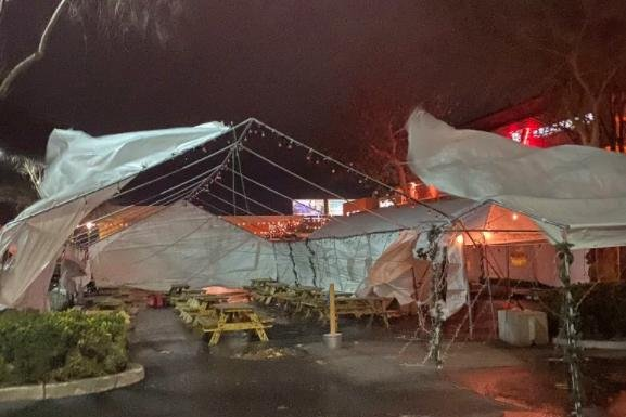 In Sacramento, tents set up for outdoor dining were ripped to pieces by fierce winds on Wednesday. Photo courtesy of @StocktonPolice