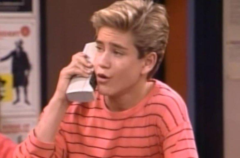 Preppy kid Zack Morris (Mark-Paul Harry Gosselaar) talks on his mobile phone in the TV series Saved By the Bell. (Screenshot via YouTube)