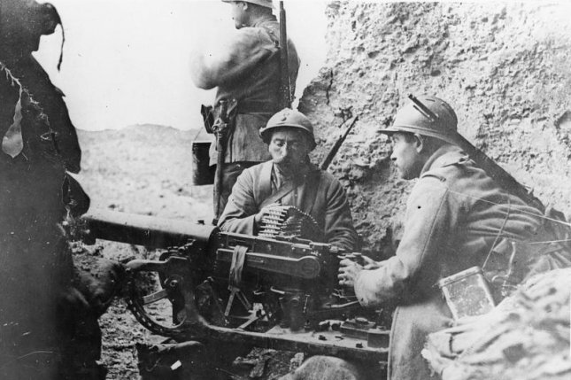 French troops manning a captured German Maxim MG 08 machine gun (mounted on a sledge) at Fort Douaumont, Verdun. Photo courtesy Imperial War Museum