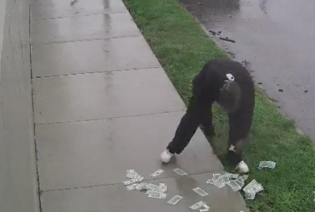 A man who robbed a credit union in Pennsylvania spent time scooping a pile of cash of the sidewalk after the money fell out of his pocket as he fled the scene on a bicycle. 