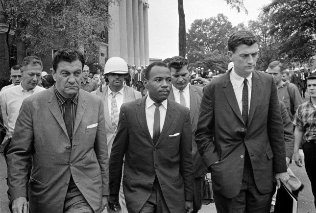 James Meredith is accompanied by a pair of U.S Marshals onto the campus of the University of Mississippi on October 1, 1962. Photo by Marion S. Trikosko/Library of Congress