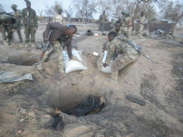 The Nigerian army uncovers a cache of Boko Haram supplies. Wednesday it warned against tradespeople accepting business loans from the insurgent group, warning death or recruitment await them if the loans are not repaid. Photo courtesy of the Nigerian Army/Facebook