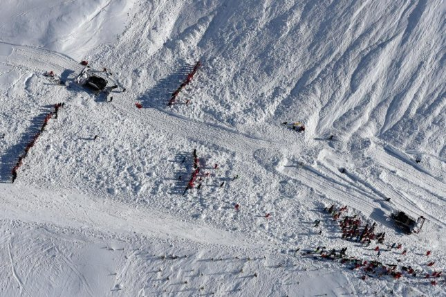 An aerial view from last year on February 13 of rescue crews working to search for victims of an avalanche near the French ski resort of Tignes. This week, five people were killed in avalanches in France and Italy/ File Photo by Sylvain Muscio/PHOTOPQR/LE/EPA