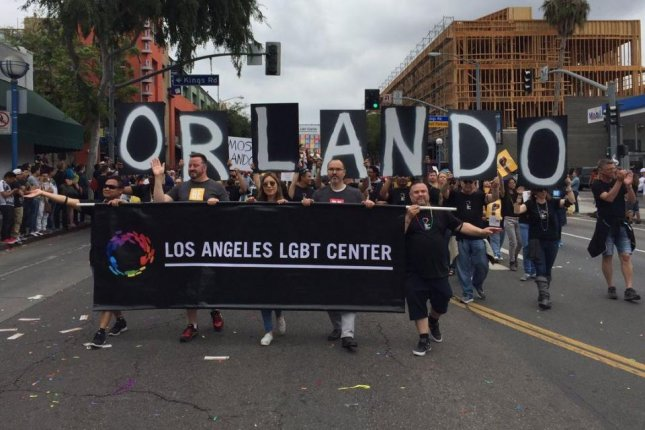 Participants in the gay pride parade in West Hollywood, Calf., remember the victims in Orlando on Sunday. Photo by LA Pride/Twitter