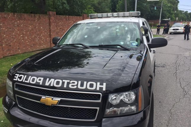 Bullet holes can be seen in a Houston Police car that arrived at a weekend shooting. A police source identified the assailant as Dionisio Garza III, a military veteran, who was killed by police. Photo courtesy of Houston Police Department/Facebook