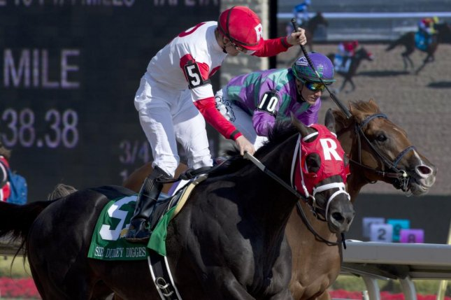 Jockey Julien Leparoux celebrates as Sir Dudley Digges lands Sunday's Queen's Plate at Woodbine -- Canada's signature race. (Woodbine photo)