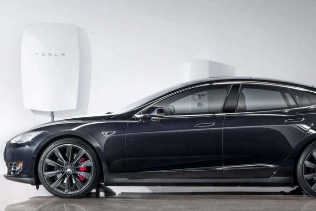 Tesla Motors announced Powerwall, a new battery storage system, that can store energy during the day and power residential homes after dark, Thursday, April 30, 2015. The batteries are about six inches thick and can hang in your garage or wall. Photo: Tesla